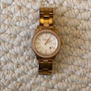 Rose gold with diamonds Michael Kors watch